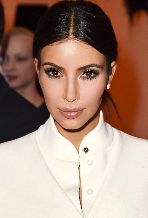 stylish ways to wear center part hairstyles Kim Kardashian121