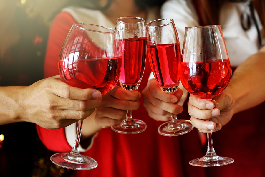 bigstock Toasting Glasses Of Red Wine F 210561166