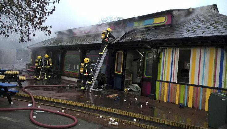 In this handout photo provided by the London Fire Brigade, firefighters work at the scene at Adventure cafe and shop near the Meerkat enclosure at London Zoo, London, Saturday, Dec. 23, 2017. London Zoo officials say a fire that broke out before the facility opened Saturday morning left one aardvark dead and four meerkats missing and presumed dead. Staff members were treated for smoke inhalation and shock after the blaze broke out near the zoo cafe in the early morning hours. (London Fire Brigade via AP)