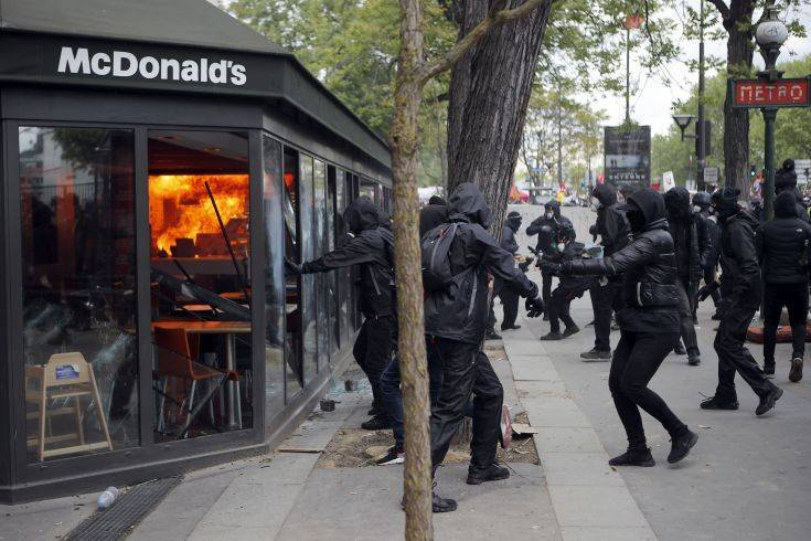 A McDonald's restaurant is hit with petrol bombs thrown by activists during the traditional May Day rally in the center of Paris, France, Tuesday, May 1, 2018. Each year, people around the world take to the streets to mark International Workers' Day, or May Day. (AP Photo/Francois Mori)
