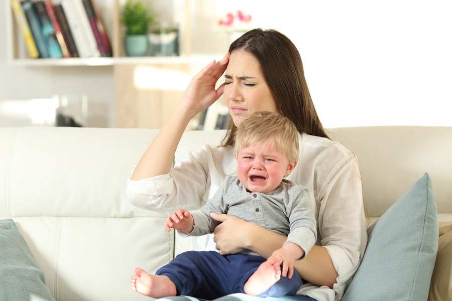 bigstock Mother Suffering And Baby Cryi 226169644