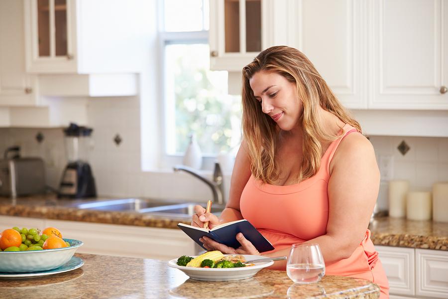 bigstock Overweight Woman On Diet Keepi 68406139