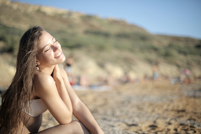 shallow focus photo of woman wearing white bikini top while 3811329