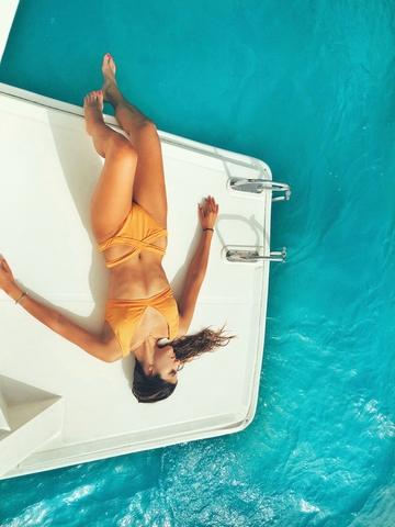 woman on white deck 1550913